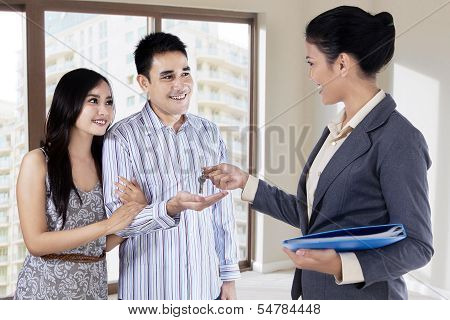 The Agent Handed The Keys To Young Couple
