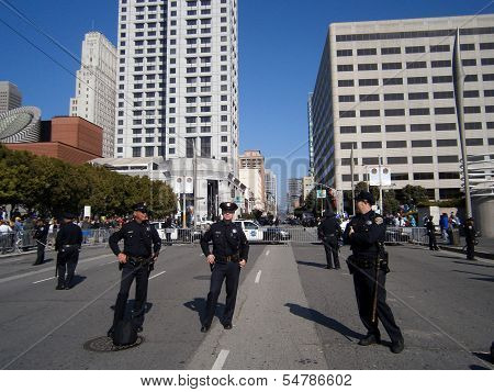 Sfpd Police Officers Stand On Street As Protesters Of Marijuana Rights Stand Behind Fence