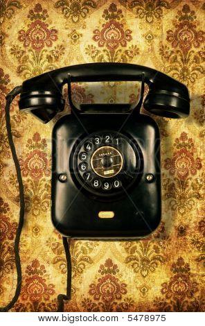 Retro Telephone On Vintage Wallpaper