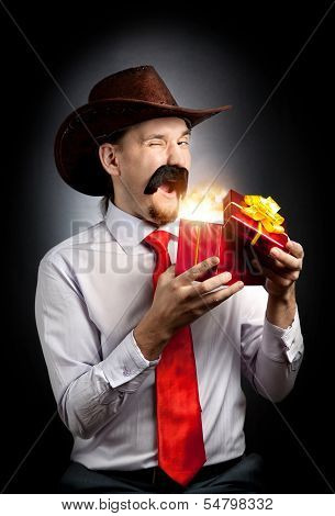 Cowboy With Red Present