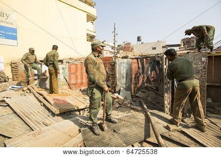 KATHMANDU, NEPAL - DEC 24, 2013: Unknown nepalese police during a operation on demolition of residential slums. In KTM is home to 50,000 squatters spread across city slums.