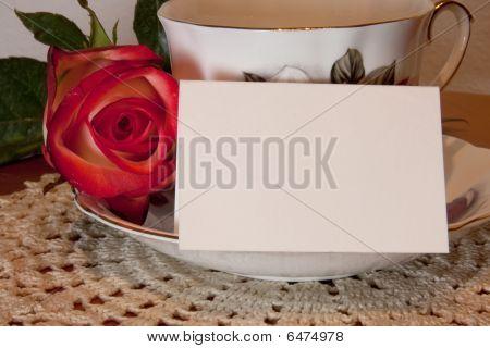 Closeup Teacup With Rose And Card