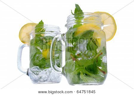 Refreshing Mint And Lemon Drink In Glass Jars