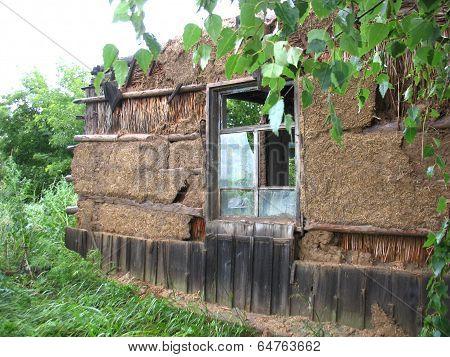 Ruinous Wall And Window Of House