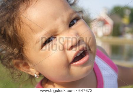 A Close-up Of A Silly Baby