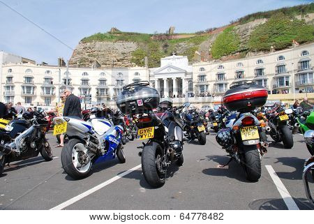 HASTINGS, ENGLAND - MAY 5, 2014: Motorcycles parked on the seafront during the annual May Day bikers rally. Started over 35 years ago, the event is now one of the biggest bike gatherings in the UK.