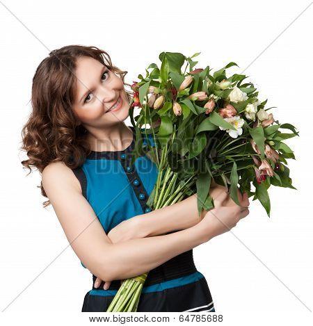 Portrait Of Pretty Brunette Holding Bouquet Of Flowers