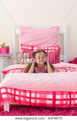 Beautiful Girl Listening Music With Headphones