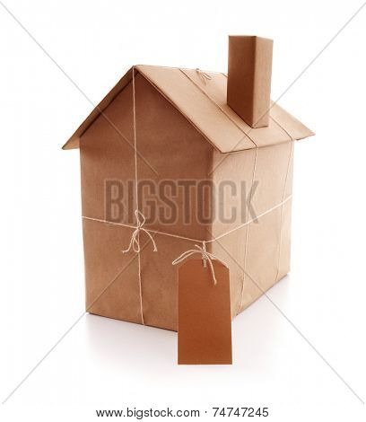 New house wrapped in brown paper concept for real estate, buying a new home, construction or moving house