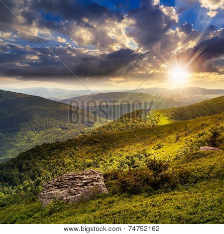 Light On Stone Mountain Slope With Forest At Sunset