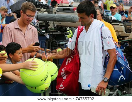 Six times Grand Slam champion Novak Djokovic signing autographs after US Open 2014 match