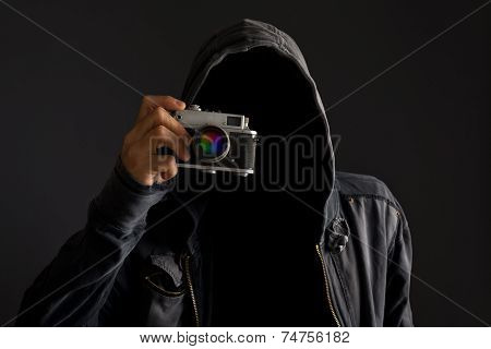 Faceless Man With Dusty Camera