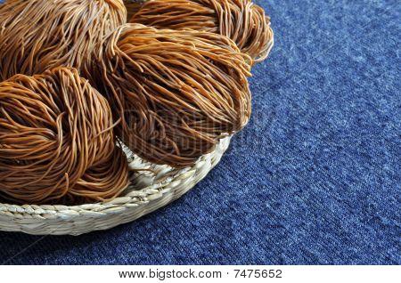 Dried noode in basket