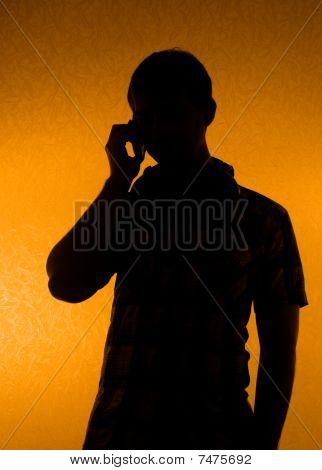 Silhouette Of Man Speak Over The Phone