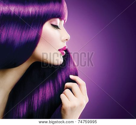 Beauty Model Woman with perfect make up and Healthy coloring violet Hair. Glamour Beautiful girl taking her long smooth shiny straight hair. Hairstyle. Hair cosmetics, haircare