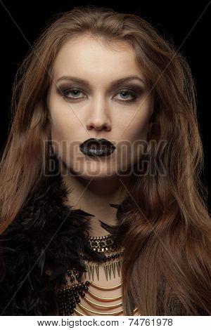 Closeup portrait of a gothic femme fatale with black lips