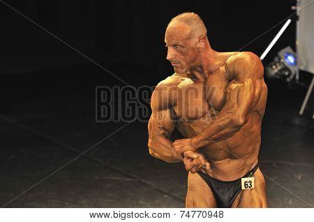 Male Bodybuilder Showing His Best