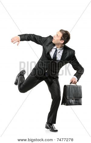 An afraid businessman running away