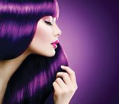 Beauty Model Woman with perfect make up and Healthy coloring violet Hair. Glamour Beautiful girl taking her long smooth shiny straight hair. Hairstyle. Hair cosmetics, haircare  poster