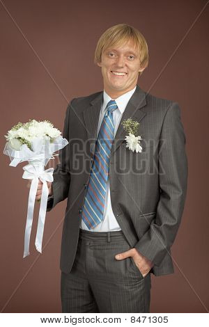 Happily Smiling Groom With Bunch
