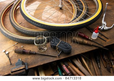 Bicycle repair. Repairing or changing a tire, tire tubes and brakes wires of an vintage bicycle.
