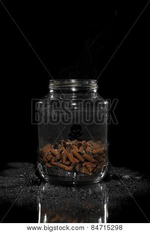 Jar full of cigarette butts. Stop smoking concept.