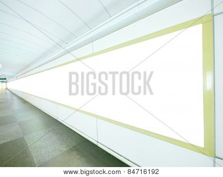 Long blank billboard on wall