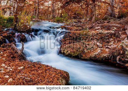 Beautiful Fall Foliage and Waterfall On The Guadalupe River, Texas.