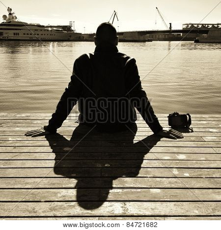 photographer taking a break in sepia toning