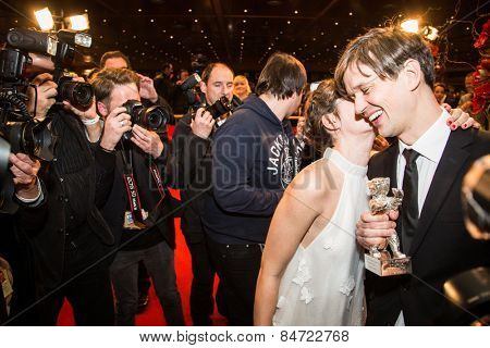 BERLIN, GERMANY - FEBRUARY 14: L. Costa kisses S. B. Grovlen at the Closing Ceremony of the 65th Berlinale International Film Festival at Berlinale Palace on February 14, 2015 in Berlin, Germany