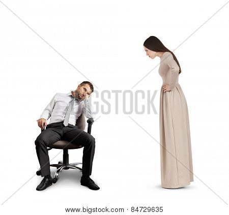 strict woman looking at tired man in chair. isolated on white background