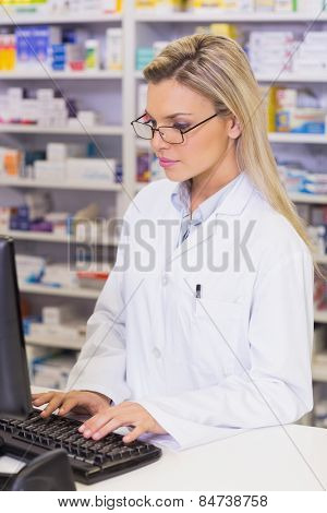 Pharmacist using the computer at the hospital pharmacy