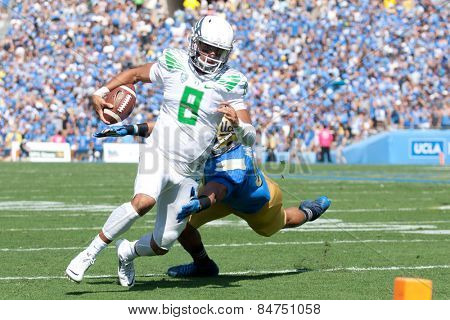 PASADENA, CA. - OCT 11: Oregon QB Marcus Mariota in action during the UCLA football game on October 11th 2014 in Pasadena, California.