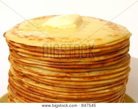 heap of pancakes with thaw piece of butter