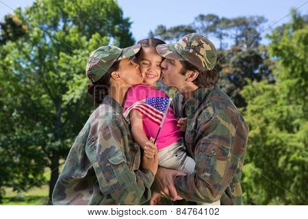 Army parents reunited with their daughter on a sunny day