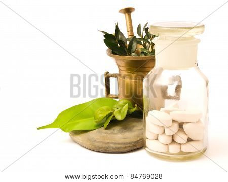 Mortar with herbs, and pharmacy bottle. White pills and white background poster