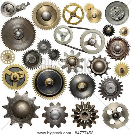 Metal gear, cogwheels, pulleys and clockwork spare parts.