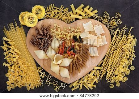 Pasta food selection on a heart shaped wooden board. poster