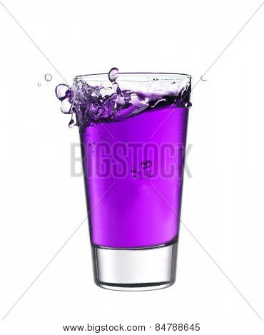 Splash in a glass of purple lemonade isolated on white background