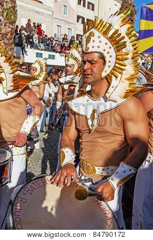 Sesimbra, Portugal. February 17, 2015: View of the Bateria, the musical section of the Samba School, playing for the dancers in the Brazilian Rio de Janeiro style Carnaval parade. With sound