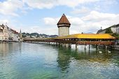 Lucerne Switzerland. Travel picture of landmark tourist attraction Kapellbrucke Chapel Bridge and Wasserturm water tower, Reuss River, Luzern. poster