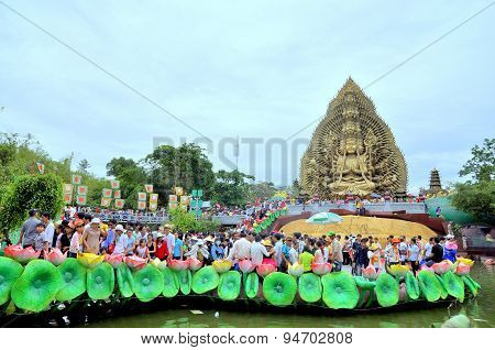 Ho Chi Minh City, Vietnam - March 31, 2012: Crowd Of Buddhists Are Offering Incense To Buddha With T