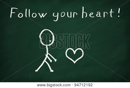 On the blackboard with chalk write Follow your heart poster