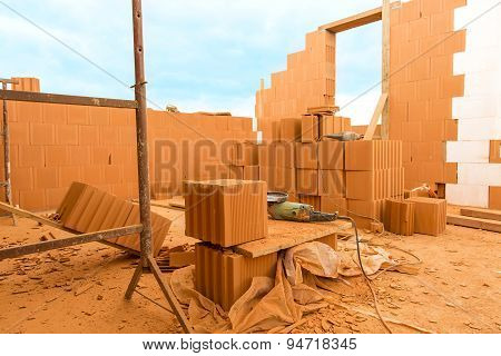Brick By Brick,  Build A House On Your Own. Building A Home. Power Tools On The Dusty Construction S