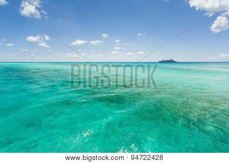 Image Of A Cruise Ship Sailing Along The Coast Line