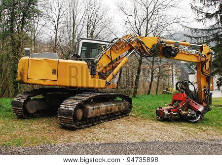 A crawler excavator with a rotating house platform on tracks. poster