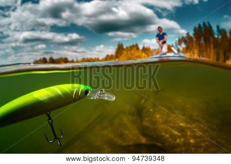 Split shot of the man fishing on the pond with plastic floating bait