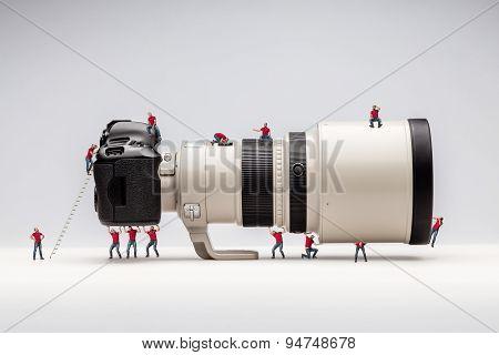 Miniature man and camera. Macro photo
