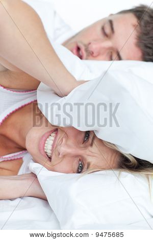 Stressed Woman Lying On The Bed With Her Boyfriend Snoring