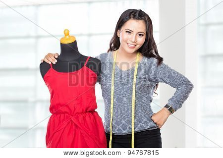Young Asian Designer Woman Posing Smiling, Hold A Scissors,  Look At The Camera